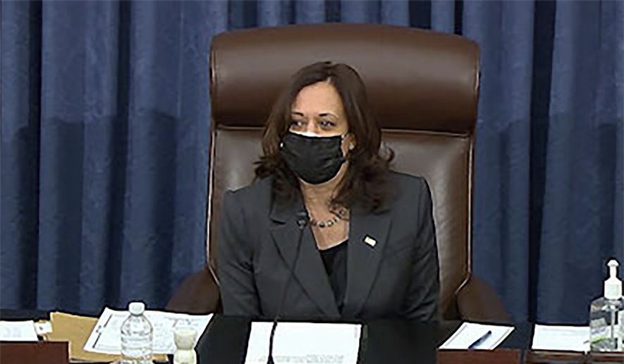In this image from Senate TV, Vice President Kamala Harris sits in the chair on the Senate floor to cast the tie-breaking vote, her first, Friday, Feb. 5, 2021, at the Capitol in Washington. The Senate early Friday approved a budget resolution that paves the way for fast-track passage of President Joe Biden's $1.9 trillion coronavirus relief plan without support from Republicans. (Senate TV via AP)