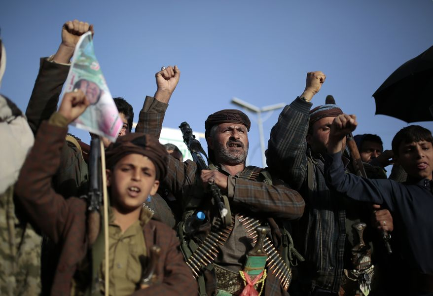 In this Jan. 25, 2021, photo, Houthi supporters chant slogans as they attend a demonstration against the United States over its decision to designate the Houthis a foreign terrorist organization in Sanaa, Yemen. President Joe Biden is distancing himself from Saudi Arabia's rulers over their war in Yemen and rights abuses. That includes Biden announcing Feb. 4, 2021, he would make good on a campaign pledge to cut U.S. support for a five-year Saudi-led military campaign in neighboring Yemen.  (AP Photo/Hani Mohammed)