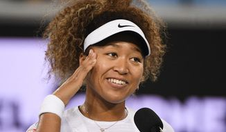 Japan's Naomi Osaka is interviewed after defeating Romania's Irina-Camelia Begu at a tuneup event ahead of the Australian Open tennis championships in Melbourne, Australia, Friday, Feb. 5, 2021.(AP Photo/Andy Brownbill)