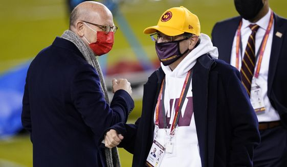 Tampa Bay Buccaneers owner Joel Glazer, left, talks with Washington Football Team owner Daniel Snyder, right, before an NFL wild-card playoff football game Saturday, Jan. 9, 2021, in Landover, Md. (AP Photo/Andrew Harnik)