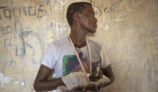 "FILE - In this Tuesday, Dec. 15, 2020 file photo, ethnic Tigrayan survivor Abrahaley Minasbo, 22, from Mai-Kadra, Ethiopia, shows his wounds from machetes, inside a shelter, in Hamdeyat Transition Center near the Sudan-Ethiopia border, in eastern Sudan. Life for civilians in Ethiopia's embattled Tigray region has become ""extremely alarming"" as hunger grows and fighting remains an obstacle to reaching millions of people with aid, the United Nations said in a new report released late Thursday, Feb. 4, 2021. (AP Photo/Nariman El-Mofty, File)"