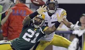 FILE - In this Feb. 6, 2011, file photo, Green Bay Packers' Charles Woodson (21) defends on a pass intended for Pittsburgh Steelers' Mike Wallace during the first half of the NFL football Super Bowl XLV football game in Arlington, Texas, in this Sunday, Feb. 6, 2011, file photo. The pass fell incomplete. Charles Woodson beat out Peyton Manning for a prestigious college award. Something called the Heisman Trophy. On Saturday, Feb. 6, 2021, they likely will share an even more impressive football honor: entry into the Pro Football Hall of Fame. (AP Photo/Dave Martin, File)