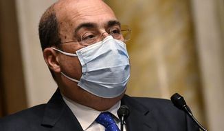 Leader of the Democratic Party, Nicola Zingaretti, addresses the media after meeting Mario Draghi, at the Chamber of Deputies in Rome, Friday, Feb. 5, 2021. Former European bank chief Mario Draghi agreed Wednesday to try to form a non-political government to steer Italy through the coronavirus pandemic after last-ditch negotiations among political parties failed to produce a viable governing coalition. (Riccardo Antimiani/Pool via AP)