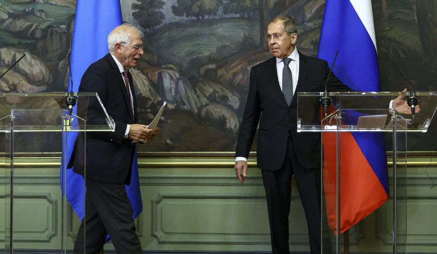 In this photo released by the Russian Foreign Ministry Press Service, Russian Foreign Minister Sergey Lavrov, right, and High Representative of the EU for Foreign Affairs and Security Policy, Josep Borrell leave a joint news conference following their talks in Moscow, Russia, Friday, Feb. 5, 2021. (Russian Foreign Ministry Press Service via AP)