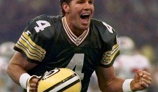 FILE - In this Jan. 26, 1997, file photo, Green Bay Packers quarterback Brett Favre celebrates after throwing a touchdown pass to Andre Rison during the NFL football Super Bowl in New Orleans. Favre looks at the quarterbacks on display this weekend with an admiration as strong as the throws he made as a Pro Football Hall of Fame player. (AP Photo/Doug Mills, File)
