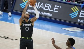 Minnesota Timberwolves guard D'Angelo Russell (0) shoots a three-point basket over Oklahoma City Thunder guard Hamidou Diallo, right, in the final seconds of an NBA basketball game Friday, Feb. 5, 2021, in Oklahoma City. (AP Photo/Sue Ogrocki)