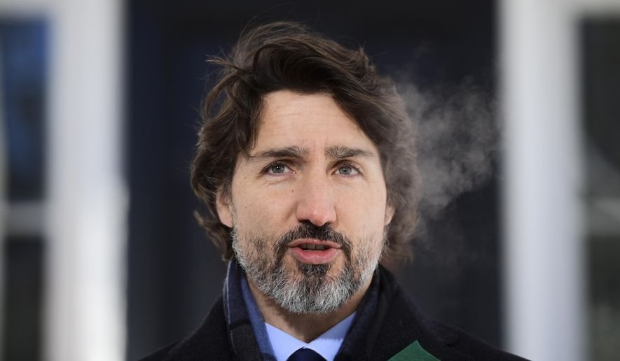 Canadian Prime Minister Justin Trudeau holds a press conference to provide an update on the COVID-19 pandemic at Rideau Cottage in Ottawa, Ontario, on Friday, Jan. 29, 2021. (Sean Kilpatrick/The Canadian Press via AP)
