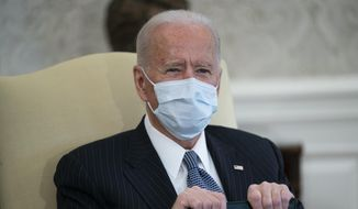 In this Feb. 3, 2021, file photo, President Joe Biden meets with Senate Majority Leader Sen. Chuck Schumer of N.Y., and other Democratic lawmakers to discuss a coronavirus relief package, in the Oval Office of the White House in Washington. (AP Photo/Evan Vucci, File)