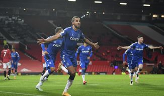 Everton's Dominic Calvert-Lewin, centre, celebrates after scoring his side's third goal during an English Premier League soccer match between Manchester United and Everton at the Old Trafford stadium in Manchester, England, Saturday Feb. 6, 2021. (Michael Regan/Pool via AP)