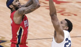 New Orleans Pelicans forward Brandon Ingram (14) shoots over Memphis Grizzlies guard Desmond Bane (22) during the first quarter of an NBA basketball game in New Orleans, Saturday, Feb. 6, 2021. (AP Photo/Derick Hingle)