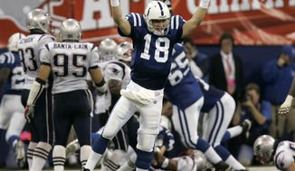 FILE - In this Jan. 21, 2007, file photo, Indianapolis Colts quarterback Peyton Manning (18) celebrates running back Joseph Addai's three-yard touchdown run in the fourth quarter of the AFC Championship football game against the New England Patriots, in Indianapolis. Charles Woodson beat out Peyton Manning for a prestigious college award. Something called the Heisman Trophy. On Saturday, Feb. 6, 2021, they likely will share an even more impressive football honor: entry into the Pro Football Hall of Fame. (AP Photo/Amy Sancetta, File)