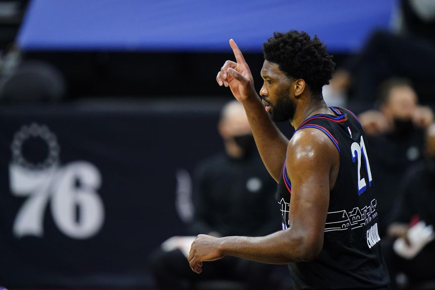 Philadelphia 76ers' Joel Embiid reacts after a basket during the second half of an NBA basketball game against the Brooklyn Nets, Saturday, Feb. 6, 2021, in Philadelphia. (AP Photo/Matt Slocum)