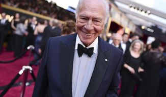 """FILE - Christopher Plummer arrives at the Oscars on March 4, 2018, in Los Angeles. Plummer, the dashing award-winning actor who played Captain von Trapp in the film """"The Sound of Music"""" and at 82 became the oldest Academy Award winner in history, has died. He was 91. Plummer, the dashing award-winning actor who played Captain von Trapp in the film """"The Sound of Music"""" and at 82 became the oldest Academy Award winner in history, has died. He was 91. Plummer died Friday morning, Feb. 5, 2021, at his home in Connecticut with his wife, Elaine Taylor, by his side, said Lou Pitt, his longtime friend and manager.  (Photo by Charles Sykes/Invision/AP, File)"""