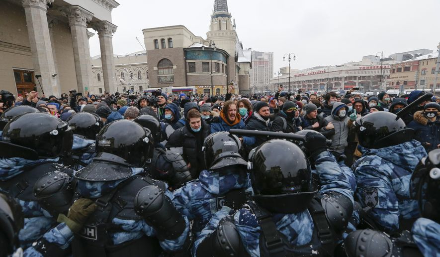 People clash with police during a protest against the jailing of opposition leader Alexei Navalny in Moscow, Russia, Sunday, Jan. 31, 2021. (AP Photo/Alexander Zemlianichenko)