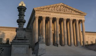 In this Friday, Nov. 6, 2020 file photo, The Supreme Court is seen at sundown in Washington. The Supreme Court is telling California it can't enforce a ban on indoor church services because of the coronavirus pandemic. The high court issued orders late Friday, Feb. 5, 2021 in two cases where churches had sued over coronavirus-related restrictions in the state. (AP Photo/J. Scott Applewhite, File)  **FILE**