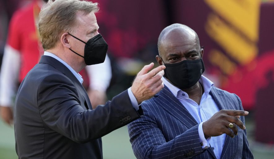 Commissioner Roger Goodell, left, and NFL Players Association executive director DeMaurice Smith talk before the NFL Super Bowl 55 football game between the Kansas City Chiefs and Tampa Bay Buccaneers, Sunday, Feb. 7, 2021, in Tampa, Fla. (AP Photo/David J. Phillip) **FILE**