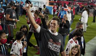 Tampa Bay Buccaneers quarterback Tom Brady walks off the field with his family after the NFL Super Bowl 55 football game against the Kansas City Chiefs Sunday, Feb. 7, 2021, in Tampa, Fla. The Buccaneers defeated the Chiefs 31-9 to win the Super Bowl. (AP Photo/Chris O'Meara) **FILE**