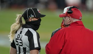 Kansas City Chiefs head coach Andy Reid, right, talks with down judge Sarah Thomas (53) during the first half of the NFL Super Bowl 55 football game against the Tampa Bay Buccaneers Sunday, Feb. 7, 2021, in Tampa, Fla. (AP Photo/Gregory Bull)