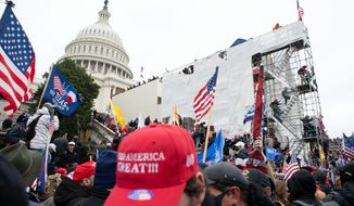 """The violent mob that stormed the Capitol on Jan. 6 were loyalists of President Trump, who launched a """"Stop the Steal"""" campaign after his election loss. Arguments begin Tuesday in the Senate trial of Mr. Trump, who is accused of incitement. (Associated Press)"""