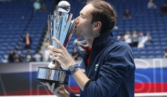 Russia's Daniil Medvedev kisses the trophy after defeating Italy in the final of the ATP Cup in Melbourne, Australia, Sunday, Feb. 7, 2021.(AP Photo/Hamish Blair)