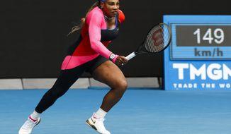 United States' Serena Williams runs to return a shot to Germany's Laura Siegemund during their first round match at the Australian Open tennis championship in Melbourne, Australia, Monday, Feb. 8, 2021.(AP Photo/Rick Rycroft)