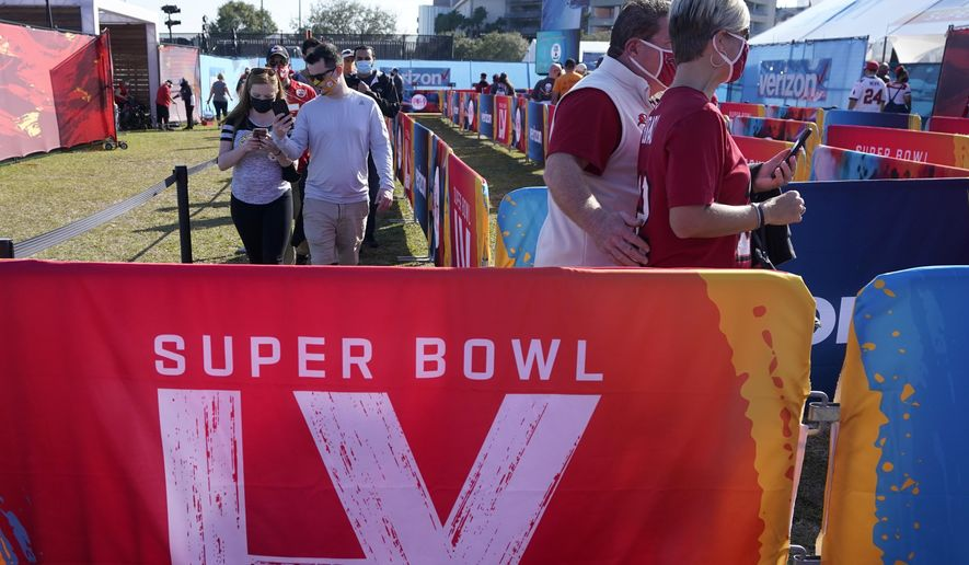 Fans arrive at Raymond James Stadium before the NFL Super Bowl 55 football game between the Kansas City Chiefs and Tampa Bay Buccaneers, Sunday, Feb. 7, 2021, in Tampa, Fla. (AP Photo/Gregory Bull)