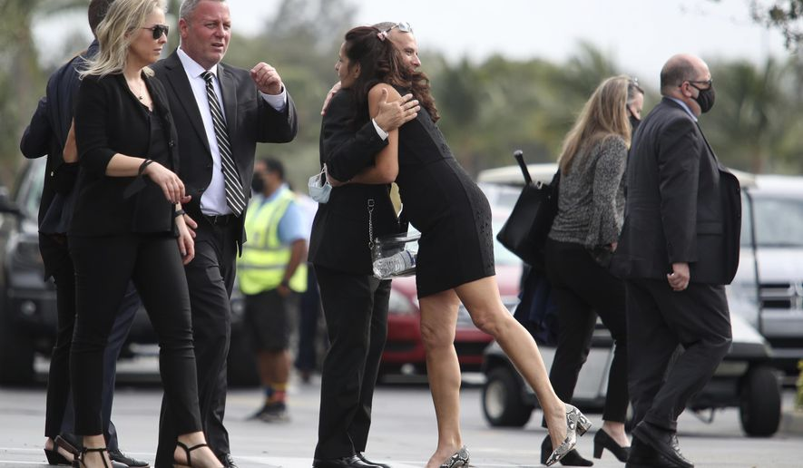 Mourners leave the memorial service honoring FBI Special Agent Daniel Alfin at Hard Rock Stadium in Miami Gardens, Fla., on Sunday, Feb. 7, 2021. Alfin, 36, was killed in Sunrise, Fla., on Tuesday in a pre-dawn ambush after he and other agents arrived at David Huber's apartment with a search warrant related to violent crimes against children.  (John McCall/South Florida Sun-Sentinel via AP)