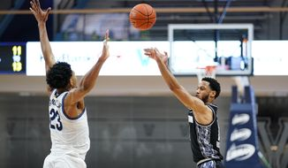 Georgetown's Jahvon Blair, right, goes up for a shot against Villanova's Jermaine Samuels during the second half of an NCAA college basketball game, Sunday, Feb. 7, 2021, in Villanova, Pa. (AP Photo/Matt Slocum)
