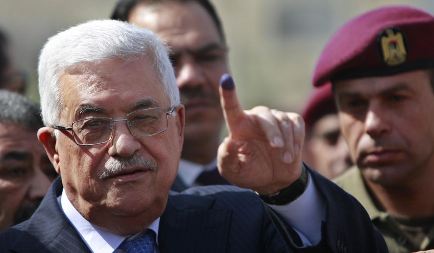 File - In this Saturday, Oct. 20, 2012 file photo, palestinian President Mahmoud Abbas shows his ink-stained finger after casting his vote during local elections at a polling station in the West Bank city of Ramallah. President Abbas called for legislative elections on May 22 and presidential elections on July 31, 2021. (AP Photo/Majdi Mohammed, File)
