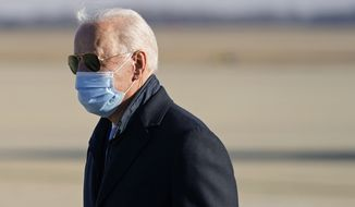 President Joe Biden steps off Air Force One at Andrews Air Force Base, Md., Monday, Feb. 8, 2021. Biden is returning to Washington after spending the weekend at his home in Delaware. (AP Photo/Patrick Semansky)