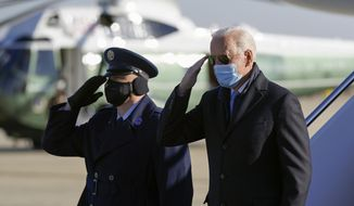 President Joe Biden salutes as he steps off Air Force One at Andrews Air Force Base, Md., Monday, Feb. 8, 2021. Biden is returning to Washington after spending the weekend at his home in Delaware. (AP Photo/Patrick Semansky)