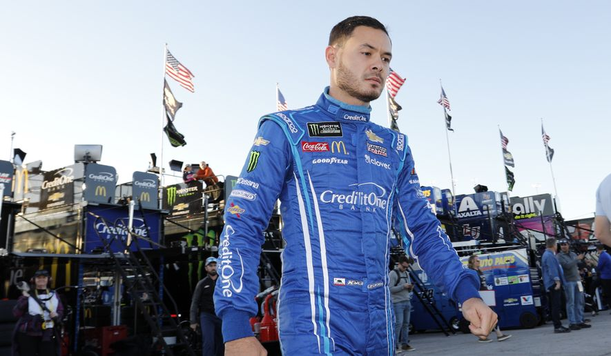 In this Oct. 18, 2019, file photo, Kyle Larson walks to the garage before the final practice for a NASCAR Cup Series auto race at Kansas Speedway in Kansas City, Kan. Kyle Larson was banished from NASCAR for all but the first month of his last season, his punishment for using a racial slur while racing online. Rick Hendrick felt the driver paid his penalty and deserved a second chance, one that begins with the season-opening Daytona 500. (AP Photo/Colin E. Braley, File) **FILE**