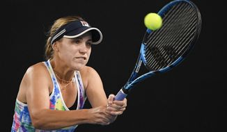 United States' Sofia Kenin makes a backhand return to Spain's Garbine Muguruza during a tuneup event ahead of the Australian Open tennis championships in Melbourne, Australia, Friday, Feb. 5, 2021.(AP Photo/Andy Brownbill)