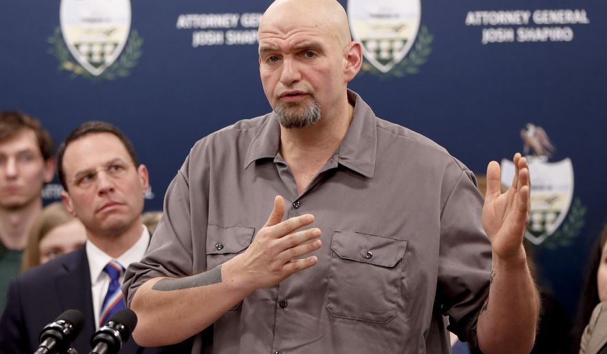 Pennsylvania Lt. Gov. John Fetterman, right, speaks as he stands beside state Attorney General Josh Shapiro during a news conference about legal action in the dispute between health insurance providers UPMC and Highmark, Thursday, Feb. 7, 2019, in Pittsburgh. (AP Photo/Keith Srakocic) ** FILE **