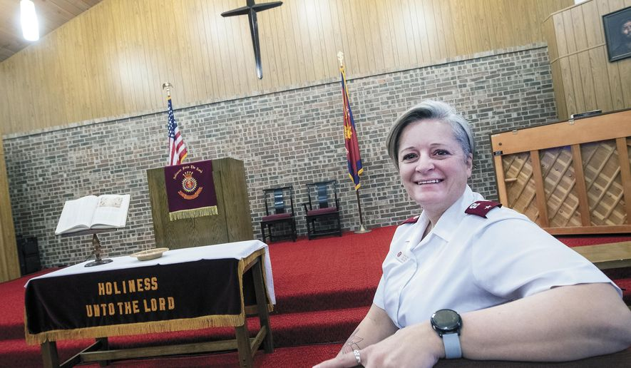 Lt. Shannon Brown, the new Corps Officer at the Hobbs Salvation Army, poses for a photo in the chapel at the Hobbs Salvation Army, Friday, Jan. 22, 2021, in Hobbs, N.M. Brown knows the struggles of homelessness and addiction. That's one of the reasons the new corps officer for the Hobbs Salvation Army wants to turn the former Thrift Store on Main Street in Hobbs into a shelter for the area's homeless. (Andy Brosig/The Hobbs Daily News-Sun via AP)