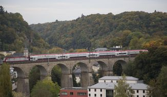 FILE - In this Oct. 19, 2013 file photo, a train passes over a stone bridge in Luxembourg. Luxembourg on Monday, Feb. 8, 2021 denied claims, made in various international media outlets, that Luxembourg is still a massive tax haven despite European Union legislation to clamp down on it. (AP Photo/Virginia Mayo, File)