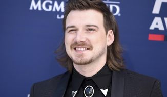 "FILE - Morgan Wallen arrives at the 54th annual Academy of Country Music Awards on April 7, 2019, in Las Vegas. Wallen fans are buying up his latest album after he appeared on a video shouting a racial slur. Wallen's sophomore record, ""Dangerous: The Double Album"" retains its top spot for a fourth week on Billboard's all-genre albums chart.(Photo by Jordan Strauss/Invision/AP, File)"