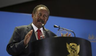 Sudanese Prime Minister Abdalla Hamdok announces new cabinet in Khartoum, Sudan, Monday, Feb. 8, 2021. The new cabinet includes rebel ministers as part of a peace deal transitional authorities stuck with a rebel alliance last year. (AP Photo/Marwan Ali)