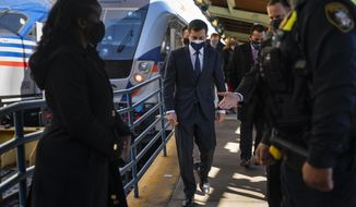 Transportation Secretary Pete Buttigieg walks from a train platform after visiting with Amtrak workers at Union Station in Washington, Friday, Feb. 5, 2021. (AP Photo/Carolyn Kaster)