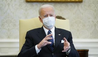 President Joe Biden meets with business leaders to discuss a coronavirus relief package in the Oval Office of the White House, Tuesday, Feb. 9, 2021, in Washington. (AP Photo/Patrick Semansky)