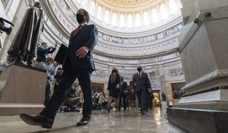 Rep. Jamie Raskin, D-Md., left, the lead Democratic House impeachment manager, and other impeachment managers, walk through the Rotunda to the Senate for the second impeachment trial of former President Donald Trump, Tuesday, Feb. 9, 2021, in Washington. (AP Photo/Alex Brandon)