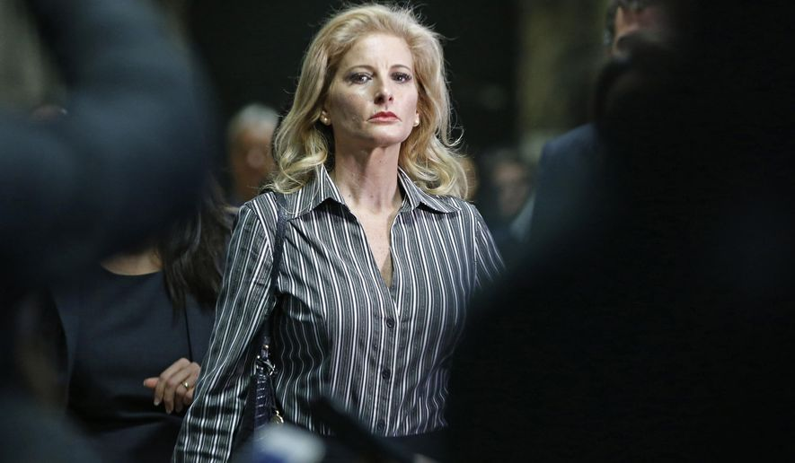 "FILE - In this Dec. 5, 2017, file photo, Summer Zervos leaves Manhattan Supreme Court at the conclusion of a hearing in New York. The former ""Apprentice"" contestant is trying to get her defamation lawsuit against former President Donald Trump moving again now that he's no longer president. (AP Photo/Kathy Willens, File)"