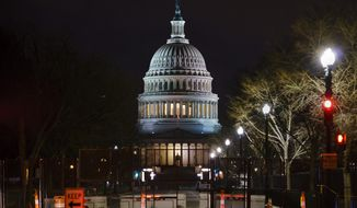 The Capitol is seen behind reinforced barricades as the second impeachment trial of former President Donald Trump begins in the Senate in Washington, Tuesday, Feb. 9, 2021. Trump was charged by the House with incitement of insurrection for his role in agitating a violent mob of his supporters that laid siege to the U.S. Capitol on Jan. 6, and sent members of Congress into hiding as they met to validate President Joe Biden's victory. (AP Photo/J. Scott Applewhite)