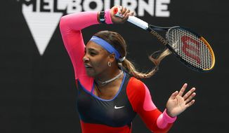 United States' Serena Williams makes a forehand return to Germany's Laura Siegemund during their first round match at the Australian Open tennis championship in Melbourne, Australia, Monday, Feb. 8, 2021.(AP Photo/Rick Rycroft)