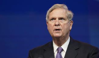 HOLD FOR STORY BY ROXANA HEGEMAN - FILE - In this Dec. 11, 2020, file photo former Agriculture Secretary Tom Vilsack, who the Biden administration chose to reprise that role, speaks during an event at The Queen theater in Wilmington, Del. Joe Biden's nomination of Vilsack to lead the Agriculture Department is getting a chilly reaction from many Black farmers who contend he didn't do enough to help them the last time he had the job. The former Iowa governor served eight years as agriculture secretary under President Barack Obama.(AP Photo/Susan Walsh, File)