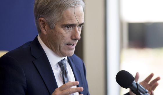 FILE - In this Nov. 19, 2020 file photo David M. DeVillers, U.S. Attorney for Southern District of Ohio, speaks at a news conference, in Kenwood, Ohio near Cincinnati. DeVillers, who was an appointee of former President Donald Trump, is leading an investigation into a $60 million bribery probe at the Ohio Statehouse, involving racketeering charges against five individuals last summer, including former Republican House Speaker Larry Householder. He says his imminent departure from the office won't affect the case. Householder and others are accused of channeling energy company money toward a legislative effort to bail out two aging nuclear power plants. (Albert Cesare/The Cincinnati Enquirer via AP, File)