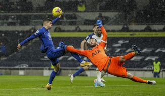 Chelsea's Christian Pulisic tries to score and Tottenham's goalkeeper Hugo Lloris, right, clears the ball during the English Premier League soccer match between Tottenham and Chelsea at the Tottenham Hotspur Stadium in London, England, Thursday, Feb. 4, 2021. (Kirsty Wigglesworth/Pool via AP)