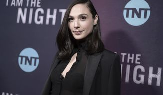 """FILE - Gal Gadot attends the premiere of """"I Am the Night"""" on Jan. 24, 2019, in Los Angeles. The 35-year-old Israeli actor's latest project has her working behind the scenes as an executive producer of """"Impact,"""" a short-form documentary series that debuts April 19 on National Geographic channel. The six-part series follows women in Brazil, California, Michigan and Puerto Rico among other places, who overcome obstacles and do extraordinary things. (Photo by Richard Shotwell/Invision/AP, File)"""