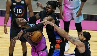 New York Knicks center Nerlens Noel (3) and forward Obi Toppin (1) block a shot to the basket by Miami Heat center Bam Adebayo (13) during the second half of an NBA basketball game, Tuesday, Feb. 9, 2021, in Miami. (AP Photo/Marta Lavandier)