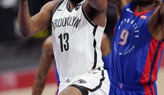 Brooklyn Nets guard James Harden (13) makes a layup as Detroit Pistons forward Jerami Grant (9) defends during the first half of an NBA basketball game, Tuesday, Feb. 9, 2021, in Detroit. (AP Photo/Carlos Osorio)